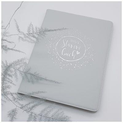 Graues Stammbuch mit Silberdruck
